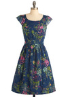 Get What You Dessert Dress in Flowers by Emily and Fin - Floral, Buttons, Pleats, Pockets, Ruffles, A-line, Cap Sleeves, Multi, Yellow, Green, Blue, Pink, Party, Vintage Inspired, Long, Fit & Flare, Exclusives, International Designer
