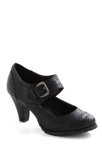 Wingtip Top Heel in Black