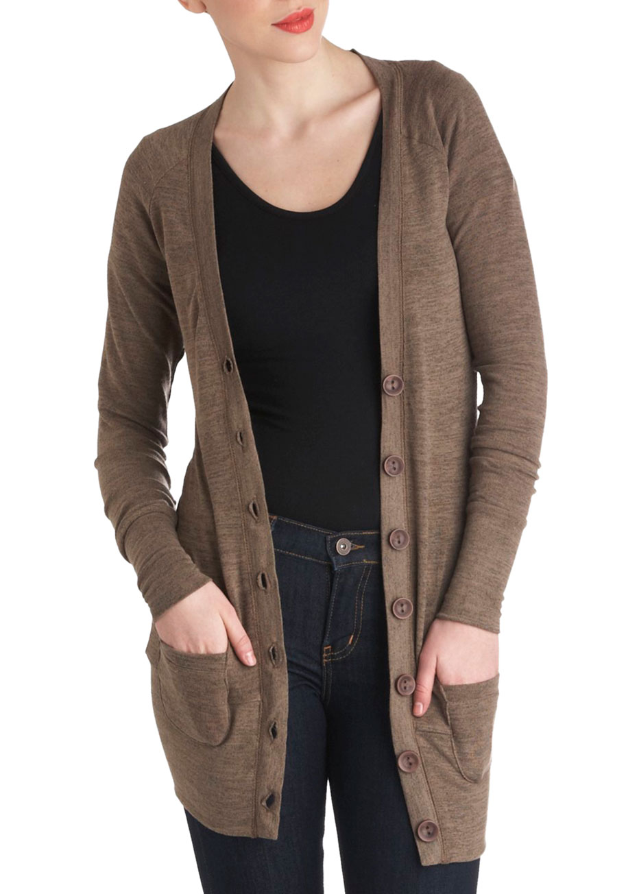 Express your style smarts in this classic brown sweater! This update to one of our most-loved styles features a tunic silhouette with buttons at each hip, long sleeves, and a soft, See More Sweaters.