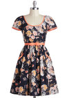 Ready to Meet Dress in Blooms by Emily and Fin - Black, Multi, Floral, Daytime Party, Fit & Flare, Short Sleeves, International Designer, Cotton, Mid-length, Orange, White, Bows, Pockets, Trim, Belted, Variation, Scoop