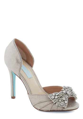 Betsey Johnson Dancing Gleam Heel in Silver by Betsey Johnson - Silver, Solid, Bows, Rhinestones, Special Occasion, Peep Toe, High, Leather, Wedding, Bridesmaid, Bride, Prom, Holiday Party, Luxe