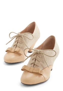 A Sheen Sweep Heel in Beige