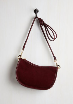 A Glam About Town Bag in Wine