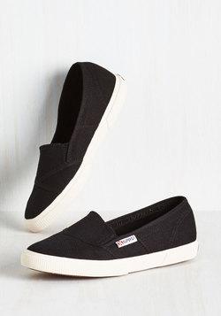 It's a Longboard Story Slip-On Sneaker in Black