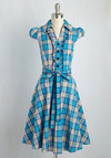 About the Artist Dress in Blue Plaid