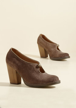 Get the Keyhole Story Suede Heel in Brown